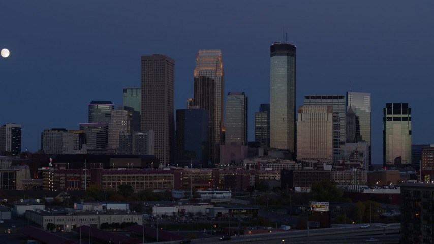 5.7K stock footage aerial video of skyscrapers in city skyline at twilight seen during ascent, Downtown Minneapolis, Minnesota Aerial Stock Footage | DX0001_002271