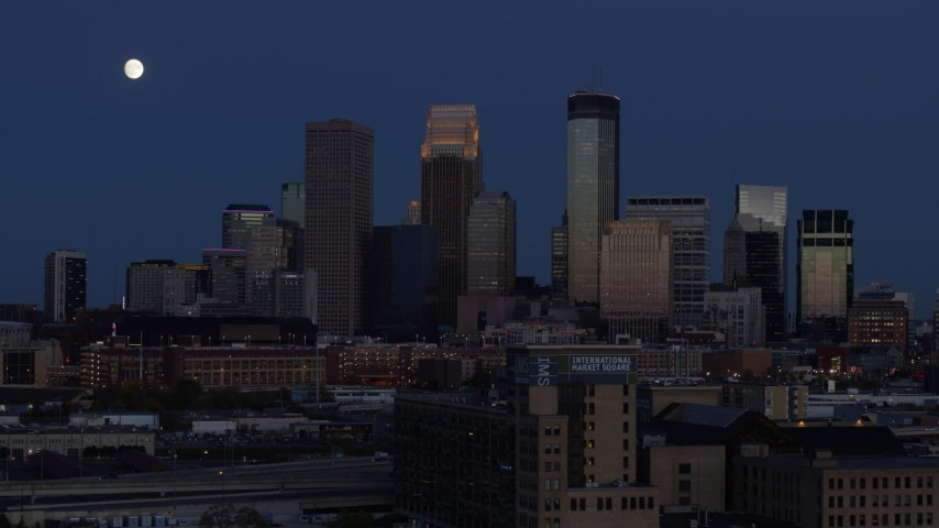 5.7K stock footage aerial video flyby the moon above skyscrapers in city skyline at twilight, Downtown Minneapolis, Minnesota Aerial Stock Footage | DX0001_002274