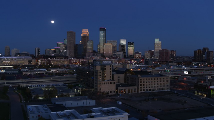 5.7K stock footage aerial video flyby market building with the moon above city skyline at twilight, Downtown Minneapolis, Minnesota Aerial Stock Footage | DX0001_002275