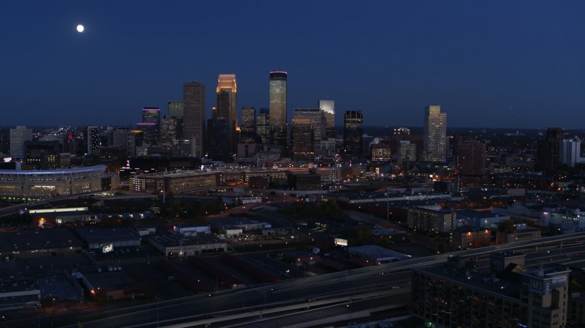 5.7K stock footage aerial video passing the moon above city skyline at twilight, Downtown Minneapolis, Minnesota Aerial Stock Footage | DX0001_002277