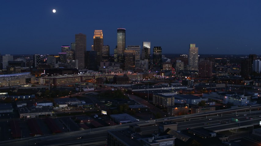 5.7K stock footage aerial video of a view of the moon above city skyline at twilight, Downtown Minneapolis, Minnesota Aerial Stock Footage | DX0001_002278
