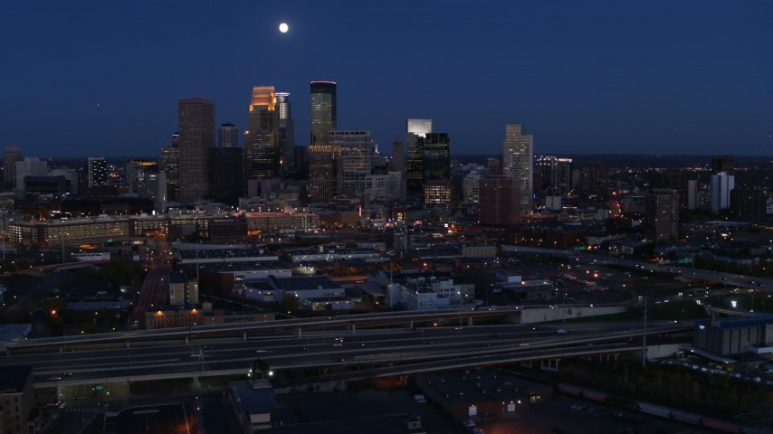 5.7K stock footage aerial video of a view of the moon above city's downtown skyline at twilight, Downtown Minneapolis, Minnesota Aerial Stock Footage | DX0001_002279