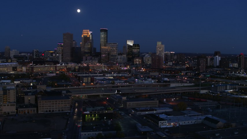 5.7K stock footage aerial video fly away from the moon above city's downtown skyline at twilight, Downtown Minneapolis, Minnesota Aerial Stock Footage | DX0001_002280