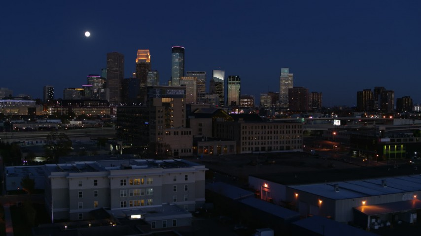 5.7K stock footage aerial video approach market building with moon above city's skyline at twilight, Downtown Minneapolis, Minnesota Aerial Stock Footage | DX0001_002283