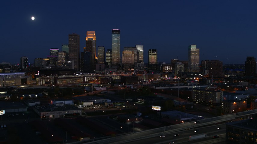 5.7K stock footage aerial video descend with view of moon above city's skyline at twilight, Downtown Minneapolis, Minnesota Aerial Stock Footage | DX0001_002284