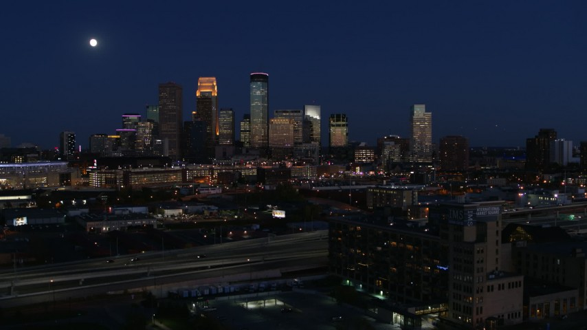 5.7K stock footage aerial video ascend to approach moon above city's skyline at twilight, Downtown Minneapolis, Minnesota Aerial Stock Footage | DX0001_002287
