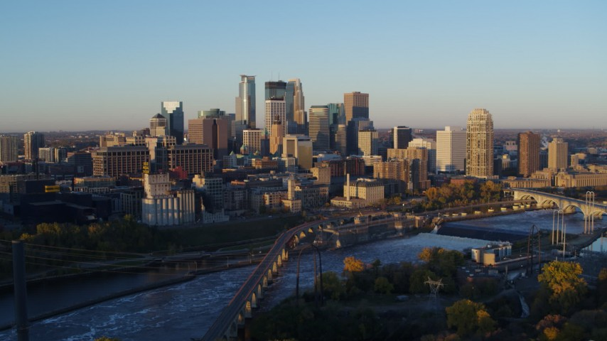 5.7K stock footage aerial video flyby bridge with the city skyline across the river at sunrise, Downtown Minneapolis, Minnesota Aerial Stock Footage | DX0001_002291
