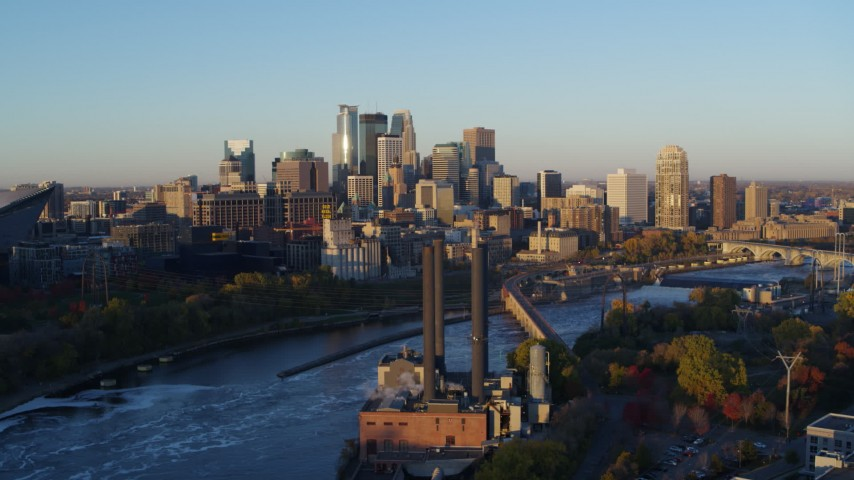 5.7K stock footage aerial video flyby power plant with the city skyline across the river at sunrise, Downtown Minneapolis, Minnesota Aerial Stock Footage | DX0001_002292