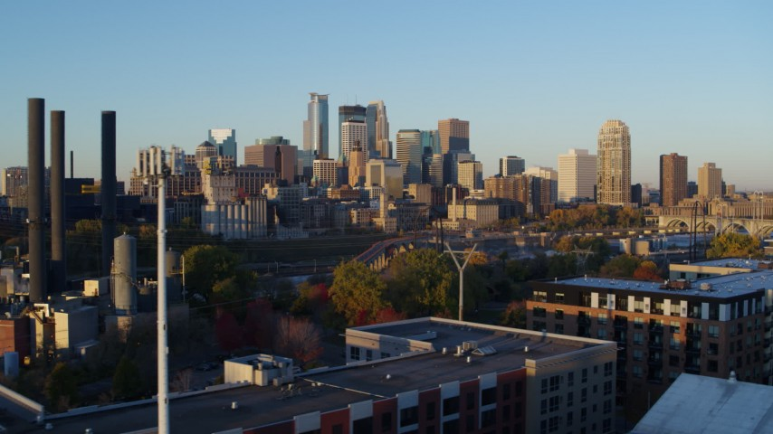 5.7K stock footage aerial video of a view of the city skyline across the river at sunrise, Downtown Minneapolis, Minnesota Aerial Stock Footage | DX0001_002293
