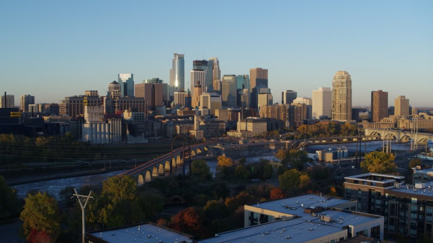 5.7K stock footage aerial video of the city skyline across the Mississippi River at sunrise, Downtown Minneapolis, Minnesota Aerial Stock Footage | DX0001_002294