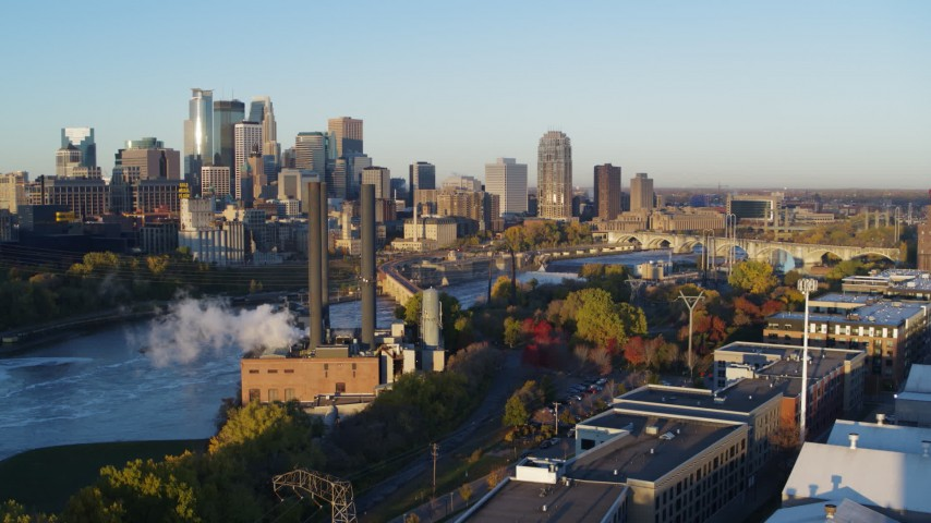 5.7K stock footage aerial video descend with view of power plant and skyline at sunrise, Downtown Minneapolis, Minnesota Aerial Stock Footage | DX0001_002301