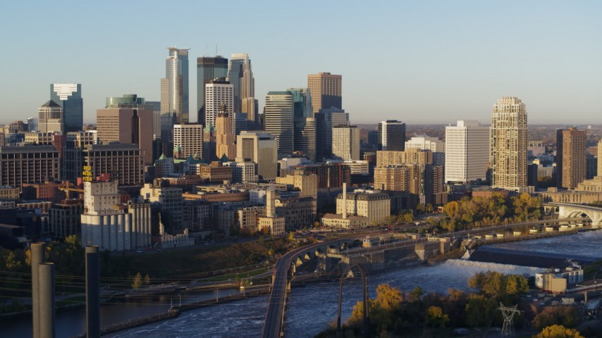 5.7K stock footage aerial video of a view of the city skyline across the Mississippi River at sunrise, Downtown Minneapolis, Minnesota Aerial Stock Footage | DX0001_002304