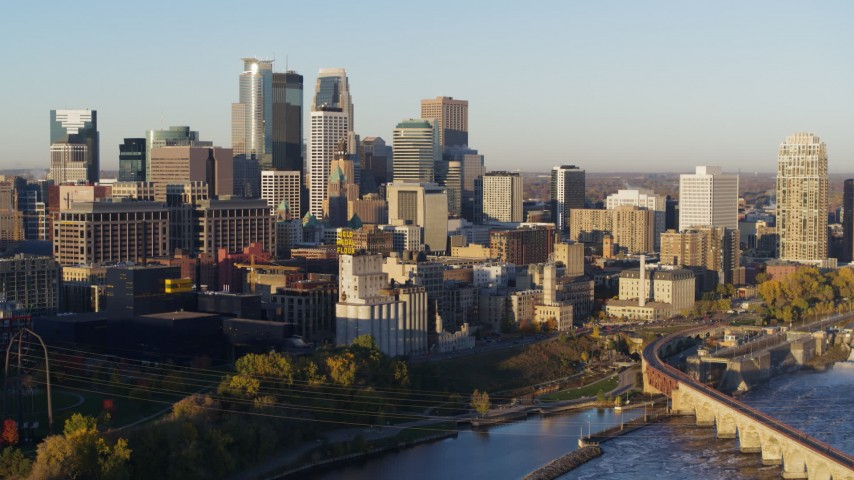 5.7K stock footage aerial video flyby power plant for view of city skyline across the river at sunrise, Downtown Minneapolis, Minnesota Aerial Stock Footage | DX0001_002306