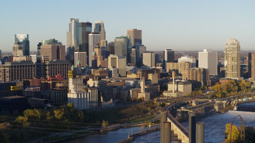 5.7K stock footage aerial video passing by the city skyline seen from the river at sunrise, Downtown Minneapolis, Minnesota Aerial Stock Footage | DX0001_002308
