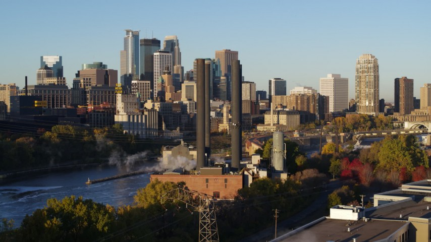 5.7K stock footage aerial video power plant and smoke stacks with skyline in background at sunrise, Downtown Minneapolis, Minnesota Aerial Stock Footage | DX0001_002313