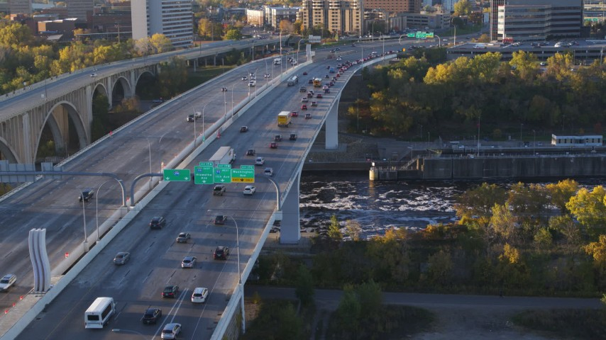 5.7K stock footage aerial video of slow traffic crossing a bridge at sunrise, Minneapolis, Minnesota Aerial Stock Footage | DX0001_002315