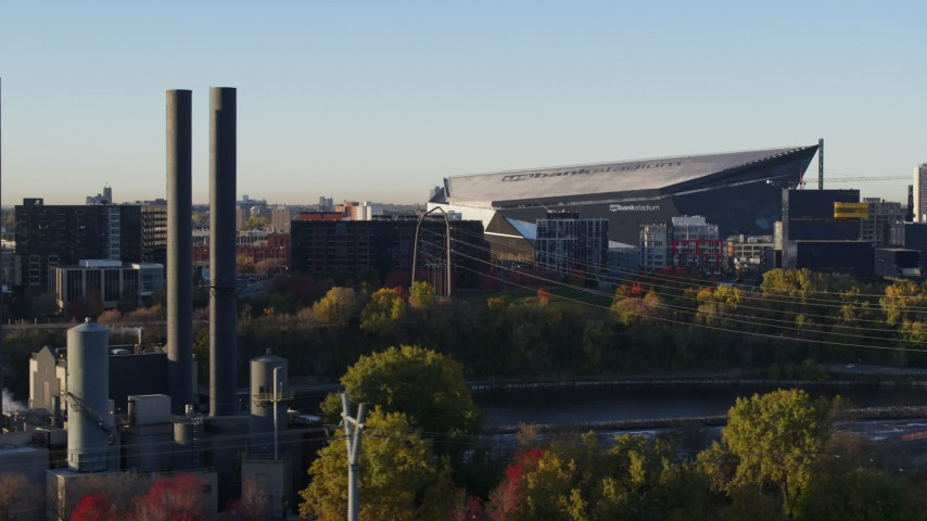 5.7K stock footage aerial video of US Bank Stadium at sunrise, seen from power plant, Downtown Minneapolis, Minnesota Aerial Stock Footage | DX0001_002318