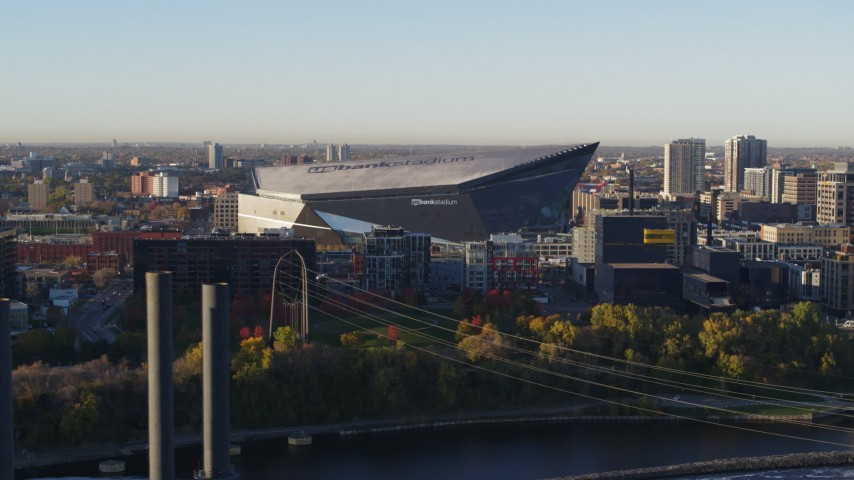 5.7K stock footage aerial video of US Bank Stadium on the other side of the river at sunrise, Downtown Minneapolis, Minnesota Aerial Stock Footage | DX0001_002319