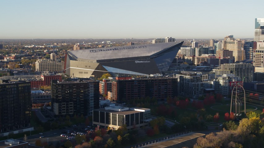 5.7K stock footage aerial video of US Bank Stadium on the other side of the river at sunrise, Downtown Minneapolis, Minnesota Aerial Stock Footage | DX0001_002320