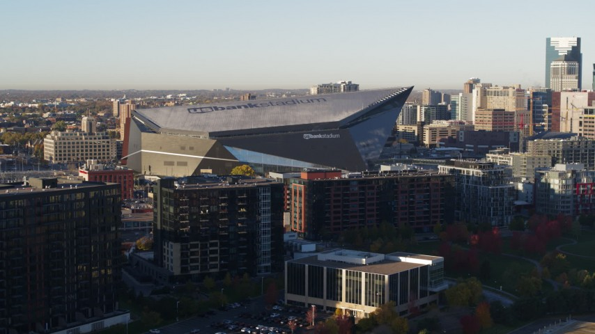 5.7K stock footage aerial video of US Bank Stadium at sunrise while descending, Downtown Minneapolis, Minnesota Aerial Stock Footage | DX0001_002321