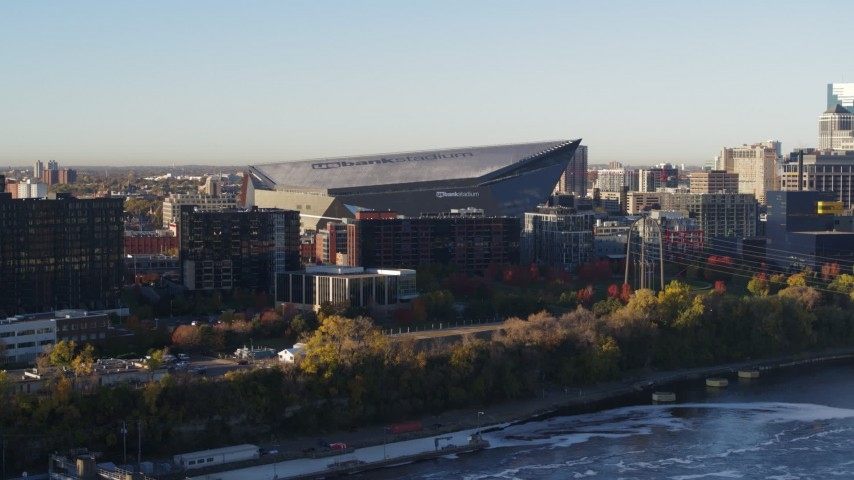 5.7K stock footage aerial video of US Bank Stadium at sunrise, seen while descending across the river, Downtown Minneapolis, Minnesota Aerial Stock Footage | DX0001_002323