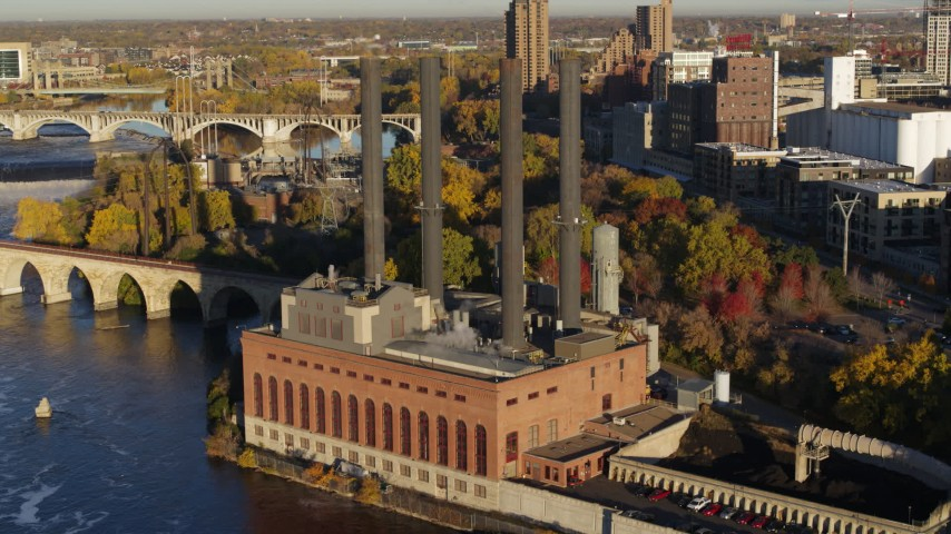 5.7K stock footage aerial video of riverfront power plant at sunrise, Minneapolis, Minnesota Aerial Stock Footage | DX0001_002325