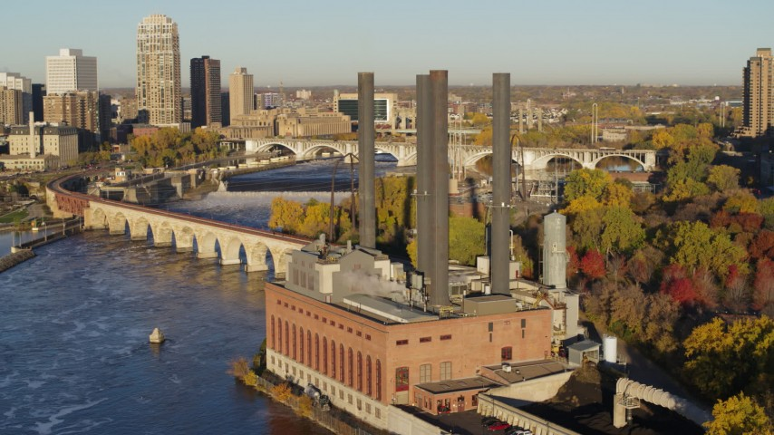 5.7K stock footage aerial video of orbiting riverfront power plant at sunrise, Minneapolis, Minnesota Aerial Stock Footage | DX0001_002326