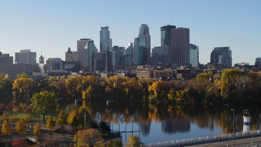 5.7K stock footage aerial video of the skyline seen from a park by the river, Downtown Minneapolis, Minnesota Aerial Stock Footage | DX0001_002328