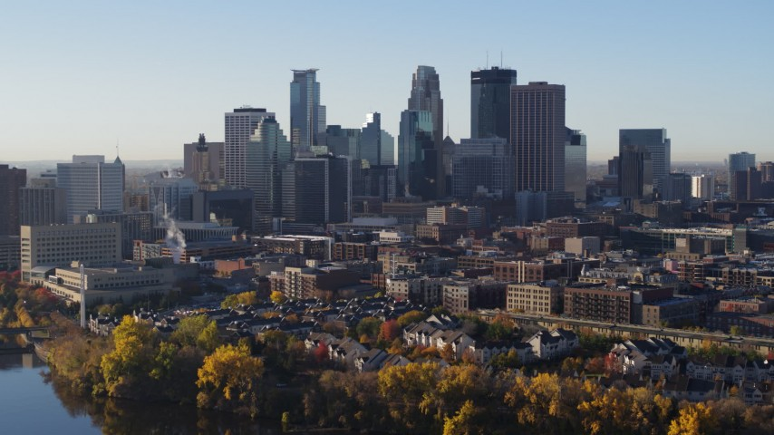 5.7K stock footage aerial video of flying by the skyline seen from the river, Downtown Minneapolis, Minnesota Aerial Stock Footage | DX0001_002330