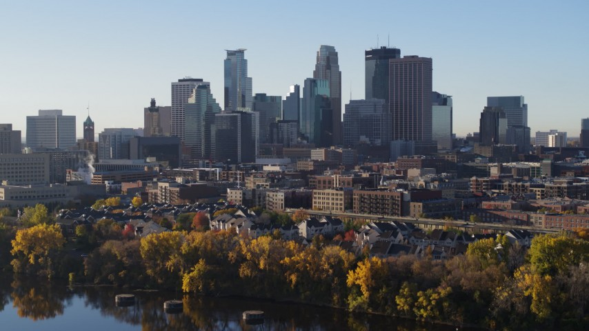 5.7K stock footage aerial video of the skyline seen during descent by the river, Downtown Minneapolis, Minnesota Aerial Stock Footage | DX0001_002331