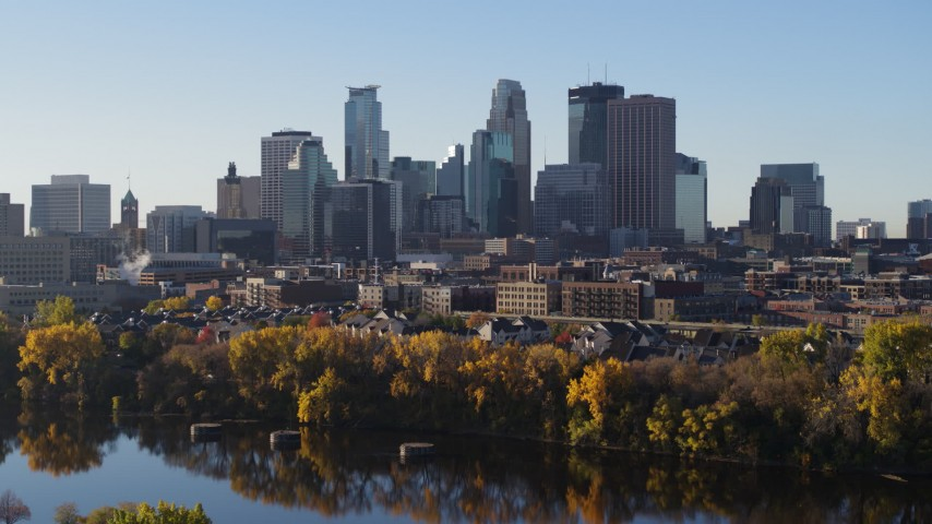 5.7K stock footage aerial video of the skyline seen during ascent by the river, Downtown Minneapolis, Minnesota Aerial Stock Footage | DX0001_002332