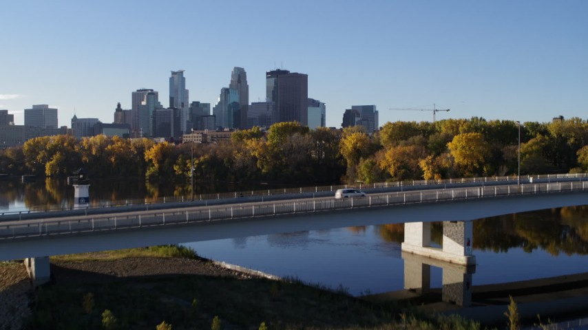 5.7K stock footage aerial video fly over bridge and river for view of city skyline, Downtown Minneapolis, Minnesota Aerial Stock Footage | DX0001_002335