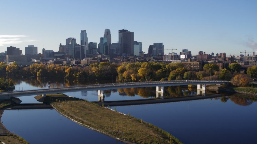 5.7K stock footage aerial video approach and flyby bridge and river, focus on skyline of Downtown Minneapolis, Minnesota Aerial Stock Footage | DX0001_002338