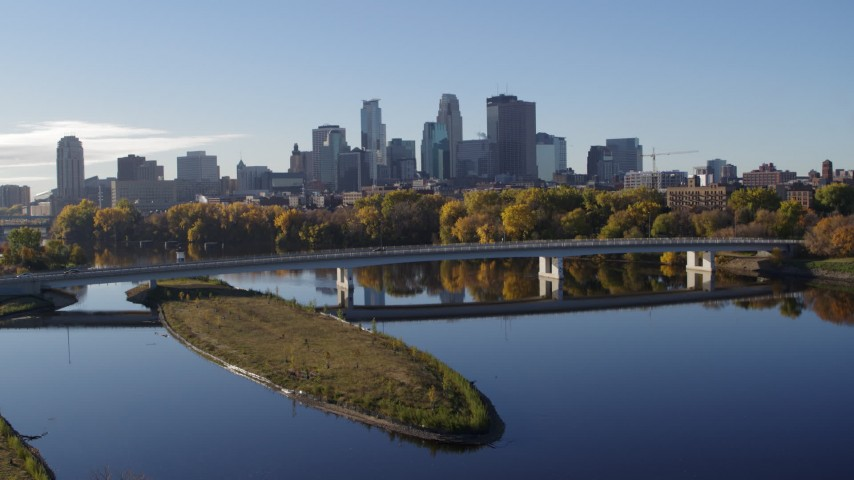 5.7K stock footage aerial video a view of the city's skyline seen from the Mississippi River, Downtown Minneapolis, Minnesota Aerial Stock Footage | DX0001_002342