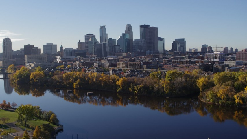 5.7K stock footage aerial video of flying by the river with a view of the skyline of Downtown Minneapolis, Minnesota Aerial Stock Footage | DX0001_002349