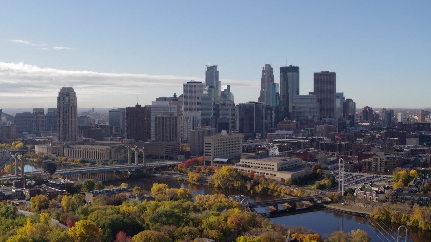 5.7K stock footage aerial video ascend to reveal the river with view of the skyline, Downtown Minneapolis, Minnesota Aerial Stock Footage | DX0001_002354