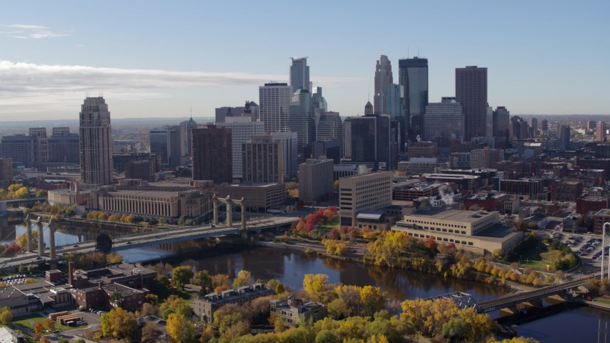 5.7K stock footage aerial video of flying by bridges spanning the river and the city's skyline, Downtown Minneapolis, Minnesota Aerial Stock Footage | DX0001_002356