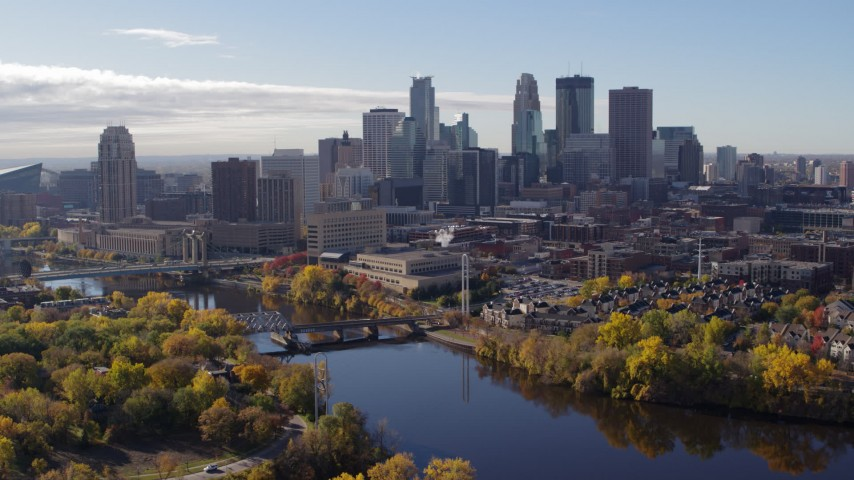 5.7K stock footage aerial video of passing by the Mississippi River and the city's skyline, Downtown Minneapolis, Minnesota Aerial Stock Footage | DX0001_002357