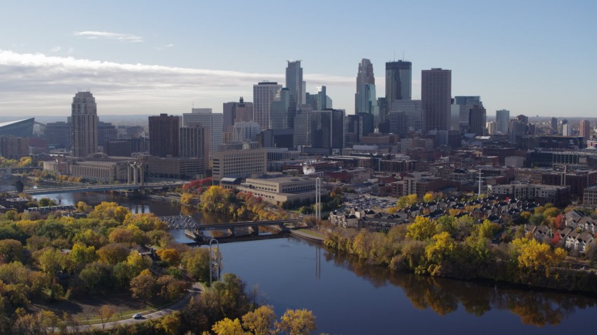 5.7K stock footage aerial video a stationary view of the city's skyline seen from the river, Downtown Minneapolis, Minnesota Aerial Stock Footage | DX0001_002361