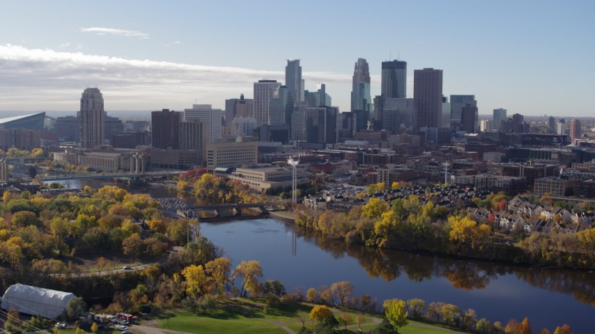 5.7K stock footage aerial video a reverse view of the city's skyline seen from the river, Downtown Minneapolis, Minnesota Aerial Stock Footage | DX0001_002362