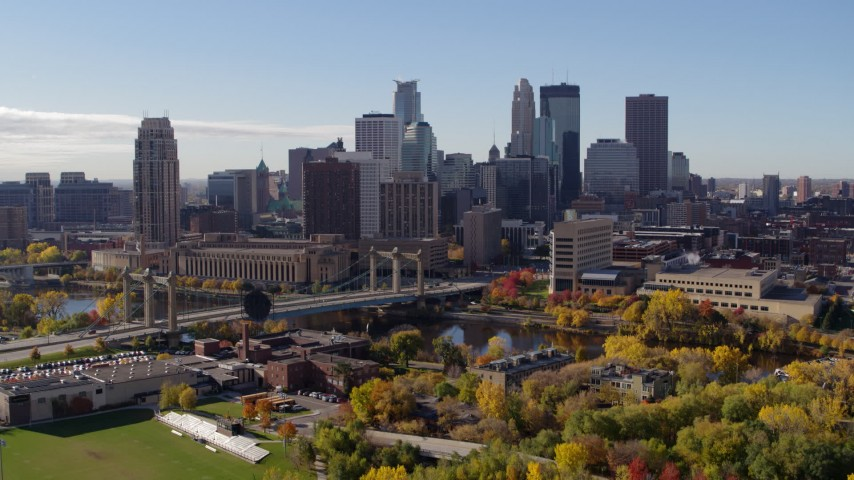 5.7K stock footage aerial video descend with view of the city's skyline and Mississippi River, Downtown Minneapolis, Minnesota Aerial Stock Footage | DX0001_002367