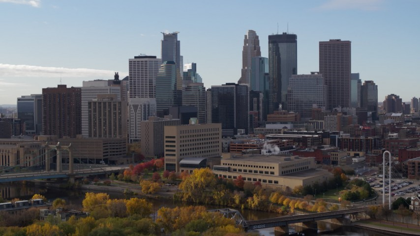 5.7K stock footage aerial video of the skyline seen while flying by the Mississippi River, Downtown Minneapolis, Minnesota Aerial Stock Footage | DX0001_002370