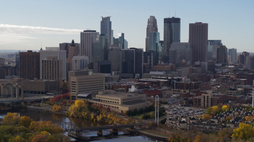 5.7K stock footage aerial video of reverse view of the skyline seen from the Mississippi River, Downtown Minneapolis, Minnesota Aerial Stock Footage | DX0001_002371