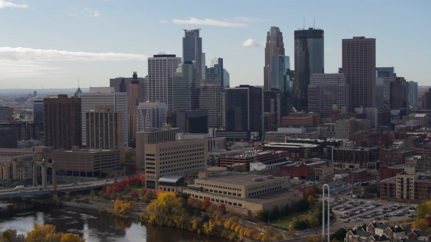 5.7K stock footage aerial video of flying by the towering skyscrapers of the city skyline, Downtown Minneapolis, Minnesota Aerial Stock Footage | DX0001_002377