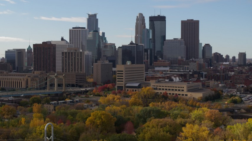 5.7K stock footage aerial video fly away from and by the towering skyscrapers of the city skyline, Downtown Minneapolis, Minnesota Aerial Stock Footage | DX0001_002379