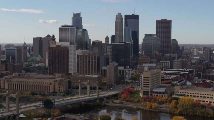 5.7K stock footage aerial video fly near bridge and towering skyscrapers of the city skyline, Downtown Minneapolis, Minnesota Aerial Stock Footage | DX0001_002381