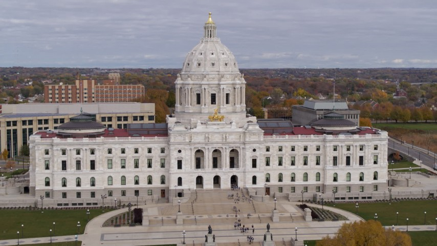 5.7K stock footage aerial video flyby the Minnesota State Capitol in Saint Paul, Minnesota with people leaving the building Aerial Stock Footage   DX0001_002394