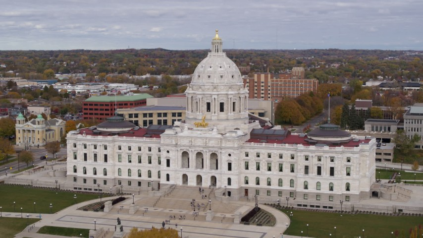 5.7K stock footage aerial video flyby the Minnesota State Capitol in Saint Paul, Minnesota as people leave the building Aerial Stock Footage   DX0001_002395