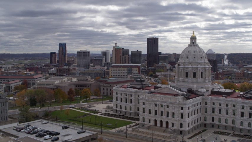 5.7K stock footage aerial video of the city skyline seen while flying by the state capitol building, Downtown Saint Paul, Minnesota Aerial Stock Footage   DX0001_002437