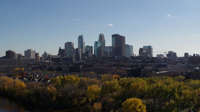 5.7K aerial video ascending with view of city skyline, Downtown Minneapolis, Minnesota Aerial Stock Footage | DX0001_002452